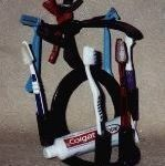 Cowboy Toothbrush Holder-Holds toothpaste, toothbrushes and razors.