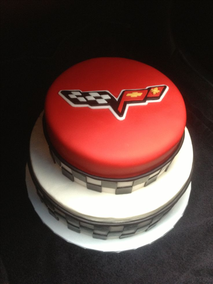 Corvette cake. Fondant top tier with fondant checkerboard and symbol.
