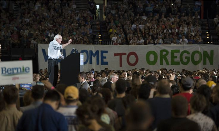 Democratic presidential candidate Sen. Bernie Sanders, I-Vt., speaks at a rally Sunday, Aug. 9, 2015, at the Moda Center in Portland, Ore. (AP Photo/Troy Wayrynen)
