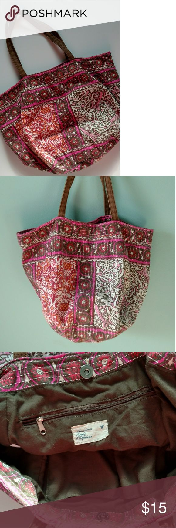 American Eagle Boho Bucket Tote Bag Soft and sturdy cotton material in beautiful summery colors and prints. White detail stitching. Circular bucket shape, double shoulder strap, magnetic snap closure. Inter zipper pocket and two open side pockets for phone and keys. Excellent used condition. American Eagle Outfitters Bags Totes