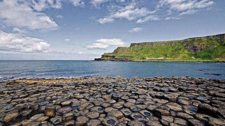 ANTRIM, IRELAND Giant's Causeway, n Ireland: Easy to see how legends grew up around this. Volcanic eruption has shaped thousands of basalt columns into precise hexagonal shapes, grouped together like organ pipes. It's almost impossible to believe that they haven't been carved by human hands. The mythology of the place has the famed warrior Finn McCool swapping shouted threats with a Scottish giant over the sea. They started to make a causeway so they could get their hands on each other.
