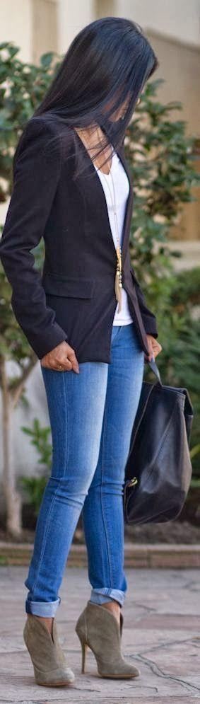 Black blazer, white t-shirt, jeans & I would wear wedge heels. ;)