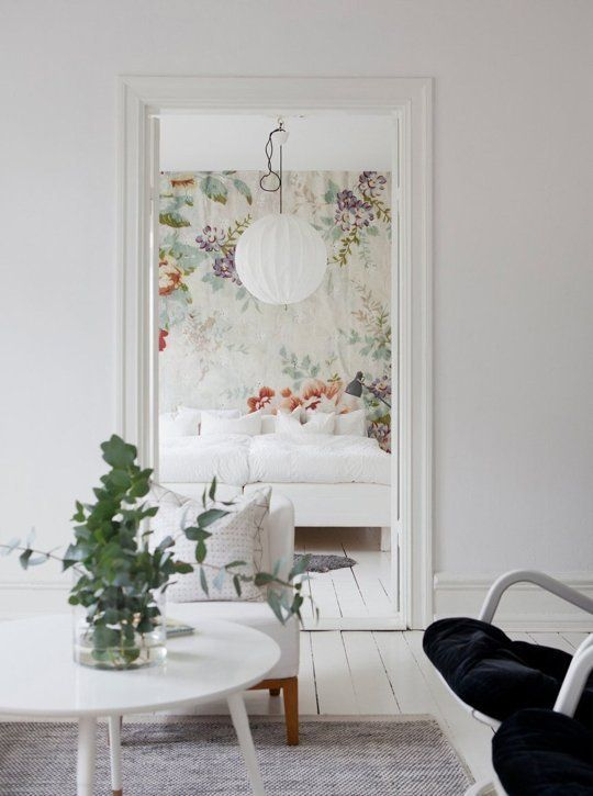 I love that white walls and floors! I'd use more colorful accent pieces via art, though:
