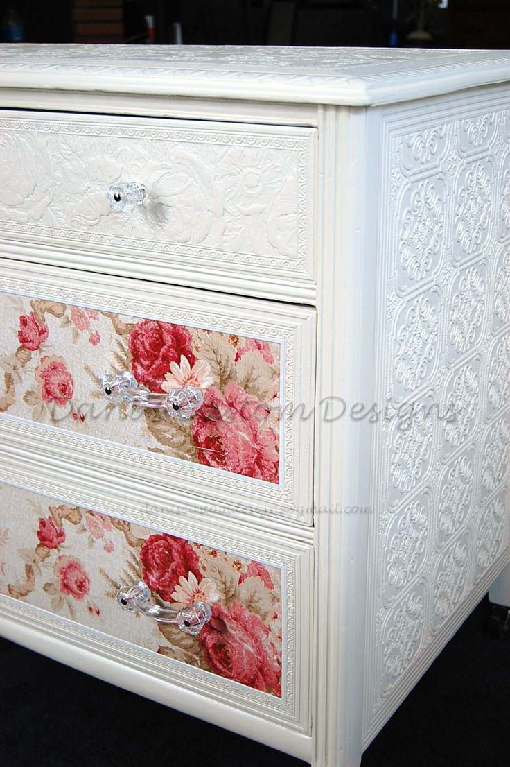 dresser covered with embossed wallpaper before painting, and floral decoupaged drawer fronts