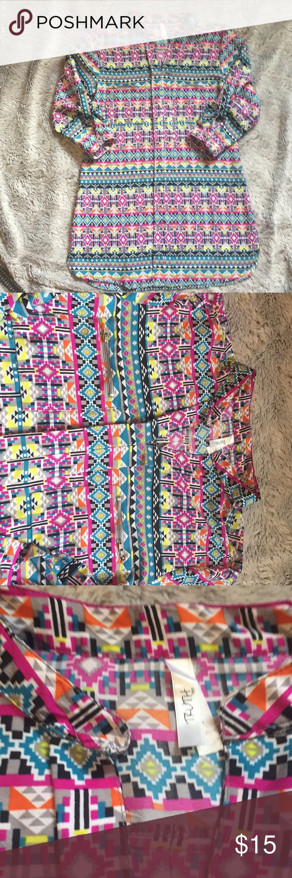 3/4 sleeve tribal tunic Super cute tunic style 3/4 sleeve tribal shirt. 100% polyester. Has zippered breast pockets. Size large but fits as a S/M. Truth NYC Tops Blouses