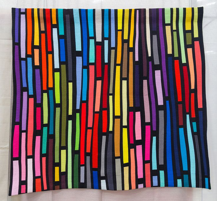 Lite Brite quilt by Maria Shell, 2014 | The Modern Quilt Guild. LITE BRITE came from a pile of small strips, arranged on a black background.