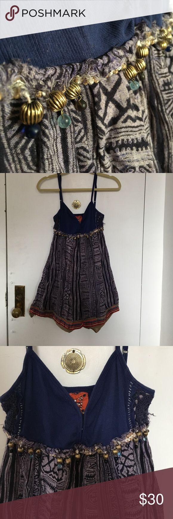 Free People Navy Beaded Mini Dress Free People navy mini dress with adjustable spaghetti straps with fun hanging beads below the chest (*some missing beads*).  Beautiful lace design on either side of the top of the dress and flared bottom with unique Gaelic pattern. Size 8 and hits mid thigh/just above the knee. Great for summer outings paired with wedges or a casual flip flop! Free People Dresses Mini