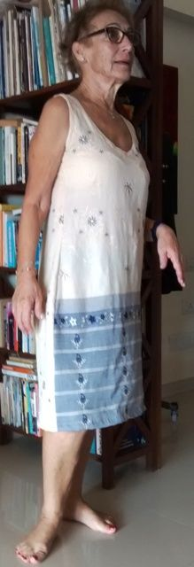 This dress made from a cotton saree. The pallu part is used for the border and a deep v neck and sleeve less