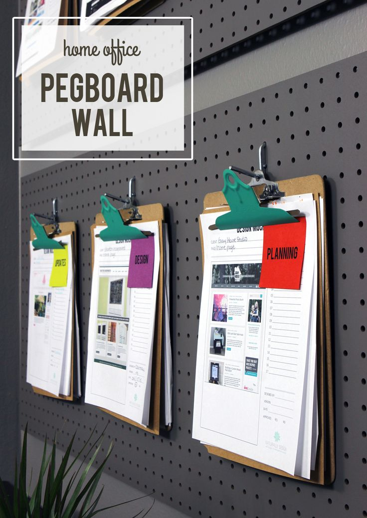 For an easy DIY office organization project, spray paint cheap clipboard metal clips and display them on a painted pegboard added to a the wall.