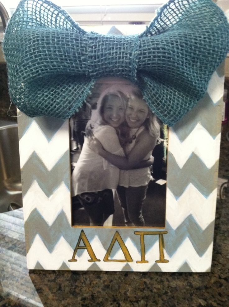 Super cute chevron picture frame with a burlap bow and your sorority's letters! Perfect for yourself or for your little!