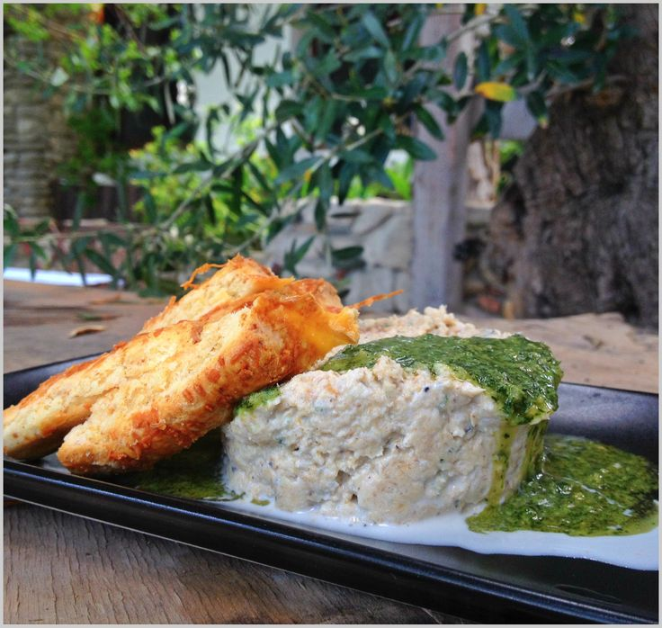 An exquisite mackerel mousse made of smoked mackerel fillet with Katiki of Domokos cheese, some fresh dill, salt and pepper. Along with it a dill pesto and some Lemonis bakery savory biscuits.
