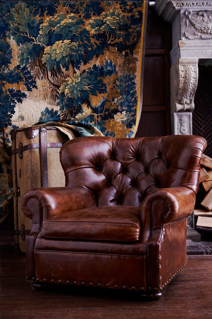 This iconic winged club chair with bold nailhead trim has a classic tufted back and bun feet