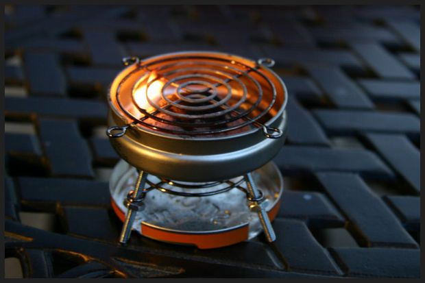 DIY Altoids Sours BBQ Grill - This one is powered by a standard-sized charcoal briquette and is capable of cooking a full-size hot dog (cut down to size) or smaller hamburger patties with ease.  It gets mighty hot after it's fired up so use plenty of caution and keep a large glass of water handy.