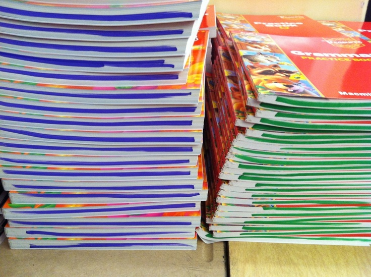 "With having so many workbooks inside desks, I just swipe a fat Mr. Sketch marker along the bottom pages of the book.  That way, when the books are piled inside their desks, they can see the colors!  When I ask my students to take out a book, I'll say something like, ""Please take out your Grammar Green book!""  It really does help, and it makes transitions quicker and easier!  And after a few weeks, my kiddos will be telling me which book is which!"