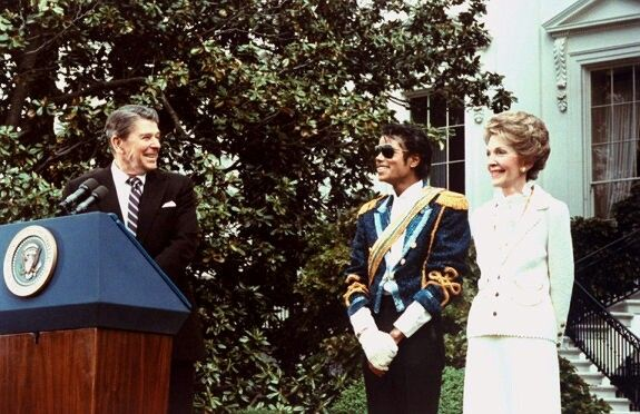 Jackson at the White House being presented with an award by President Ronald Reagan and first lady Nancy Reagan, 1984.