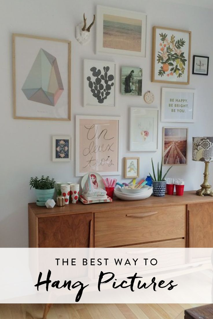While the easiest way to dress up a wall is to hang a few pictures, hanging pictures isn't always a simple task.  Try this simple hack to make sure your art is hung properly.