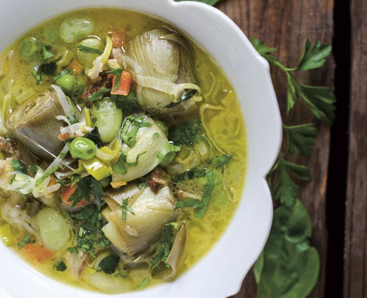 Filled with peas, artichokes, carrots and leeks seasoned with lemon, mint and basil, this Spring Vegetable Stew from Nourished Kitchen's upcoming Cookbook is amazing!