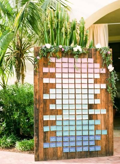 Pink to blue ombre escort cards: http://www.stylemepretty.com/2015/05/09/the-prettiest-ombre-wedding-details/