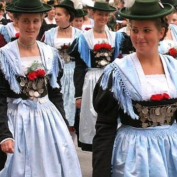 "Munich - ""Dirndls"" ... special regional and historical fashion for women, very popular to wear e.g. at the Oktoberfest"