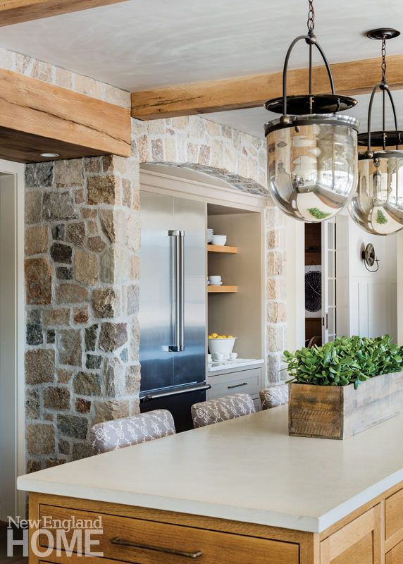 Stone And Natural Wood Add Age And Character To The Arched Space Containing The Refrigerator And