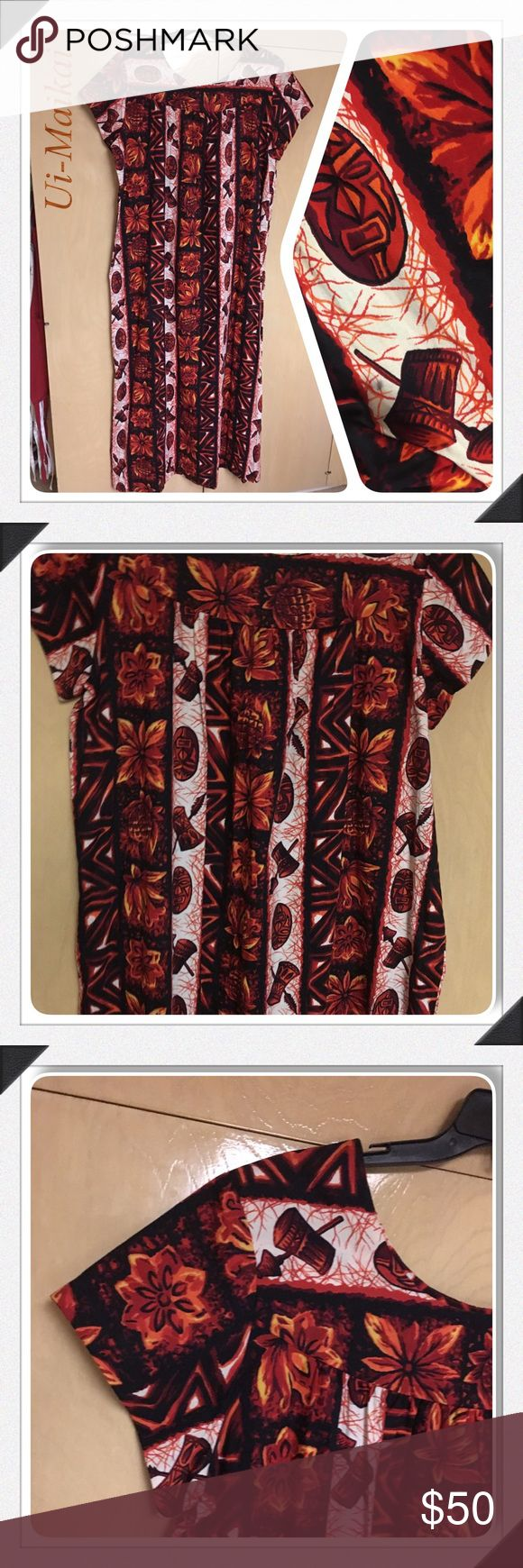 """60s Ui Maikai Brown Tiki Hawaiian Themed Dress XL Vintage Ui Maikai Short Sleeve Polynesian Full Length Tiki Luau Hawaiian Sun Dress Fab print featuring tiki masks, torches, pineapples, flowers and more!  The colors are shades of orange, red, brown cream and black - very vibrant and bright.  Pull over styling 100% Cotton  Size 18 (Vintage) / Extra Large  Measurements (approx./laying flat): Bust - 23 1/2"""" Waist - 29"""" Hips - 31"""" Length (top of shoulder to hemline) - 40"""" Excellent vintage…"""