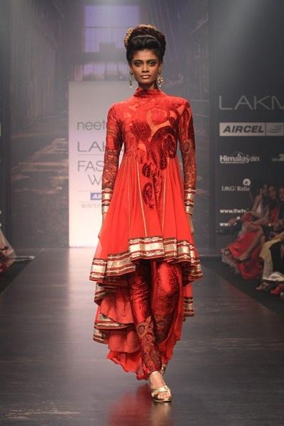 Brick red kalamkari long short brasso kurta with kalamkari patchwork churidar.