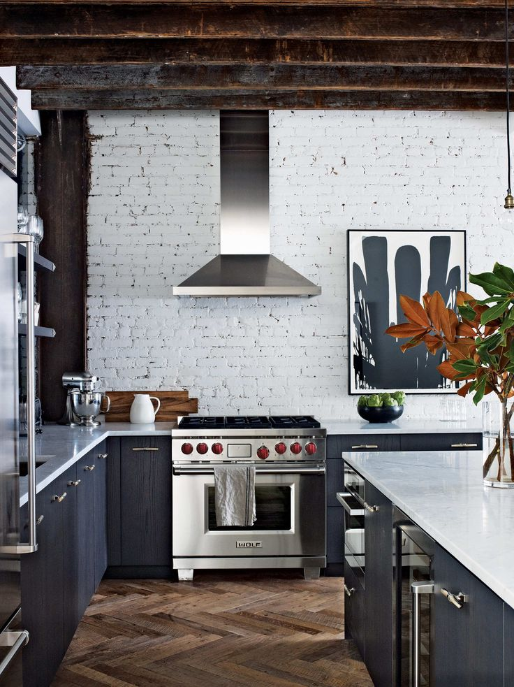 The overhead beams aren't structural, but were added to reinforce the industrial-loft vibe.  Photo: Francesco Lagnese