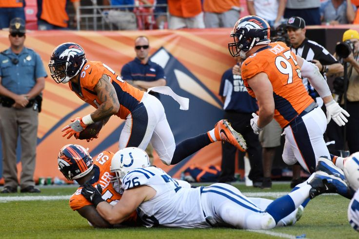 Von Miller (58) of the Denver Broncos strips Andrew Luck (12) of the Indianapolis Colts, which sets up a touchdown by Shane Ray (56) during the fourth quarter. The Denver Broncos hosted the Indianapolis Colts on Sunday, September 18, 2016. John Leyba, The Denver Post