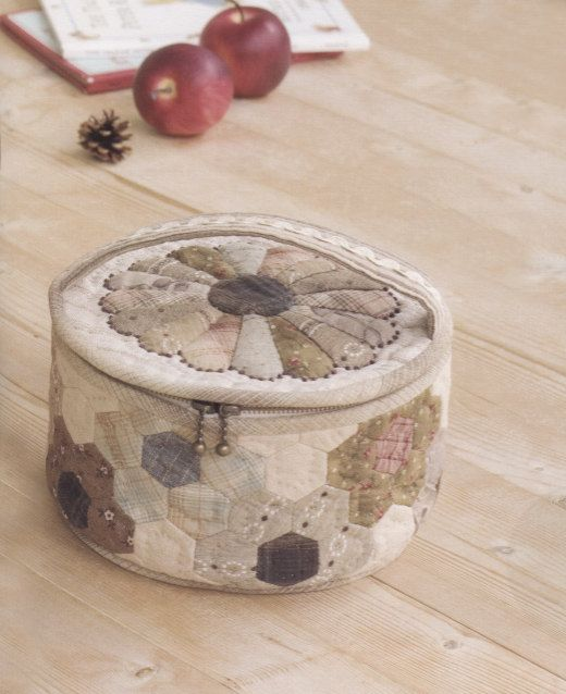 Needle work basket? with hexagons around and a mini Dresden plate on top in lovely Japanesetaupe colours.