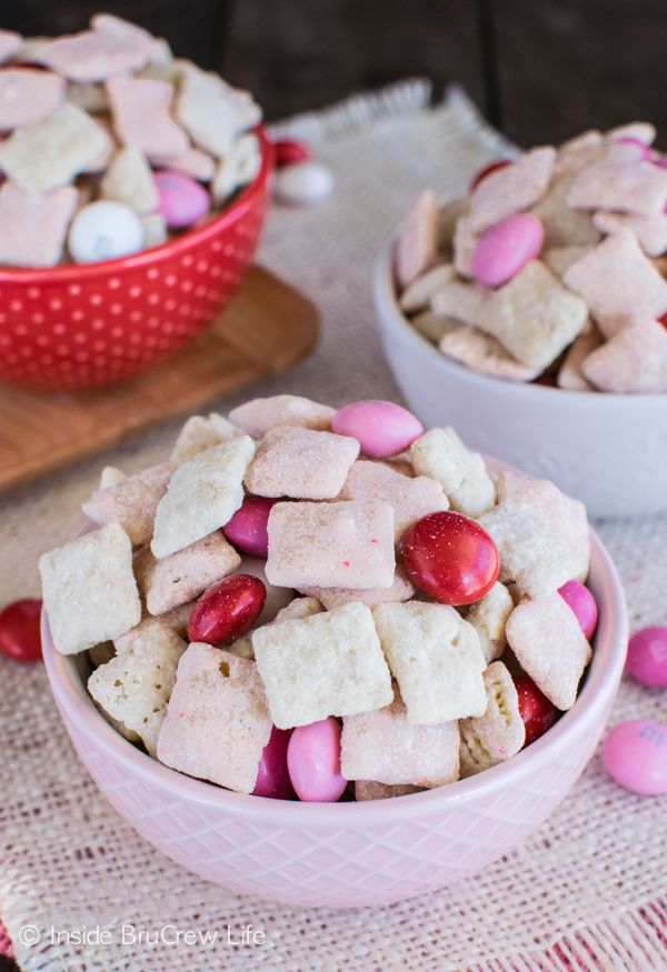 Strawberry Shortcake Muddy Buddies - this easy snack mix is coated in cookie crumbs and cake mix for a fun twist. Great dessert recipe for Valentine's day or summer picnics!