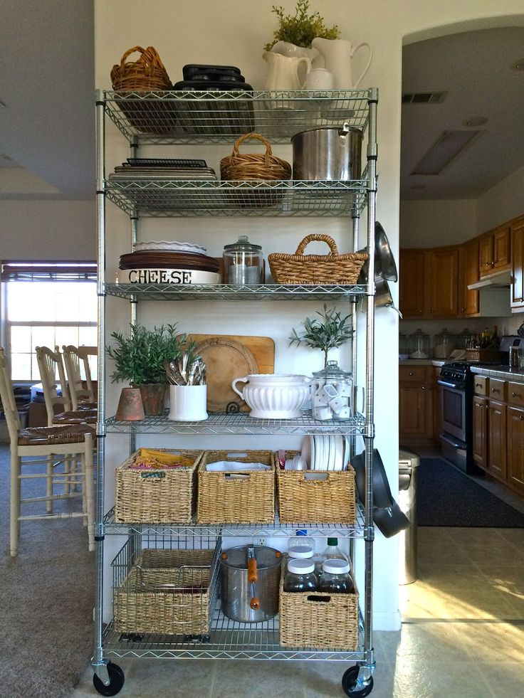Creating a Pantry - metal baker's racks and baskets are the perfect fix for creating your own pantry - where there isn't one.  This is an excellent idea - via Homestead Revival
