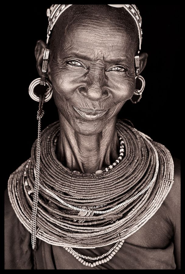 Africa | Amazing smile from a Rendille woman, North Kenya. Northern Kenya. Portraits / April 2009 by John Kenny