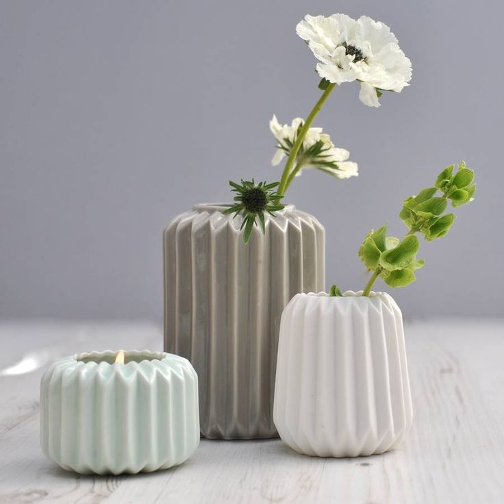Large vase in grey, medium in white and small in mint