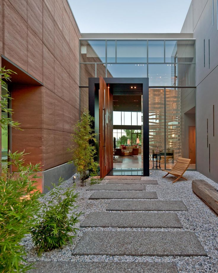 Expansive Wood Walls And Smooth Stepping Stones Lead To The Front Of This  Modern Home From AssemblageSTUDIO. Here, A Foyer Comprised Of Beautiful  Glass ...