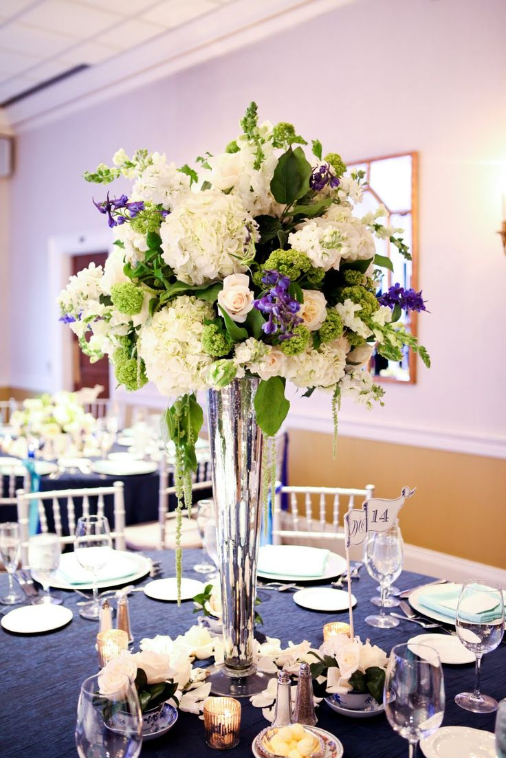 Really like the shape and the trailing bells of ireland. #trumpetvase #weddingcenterpiece