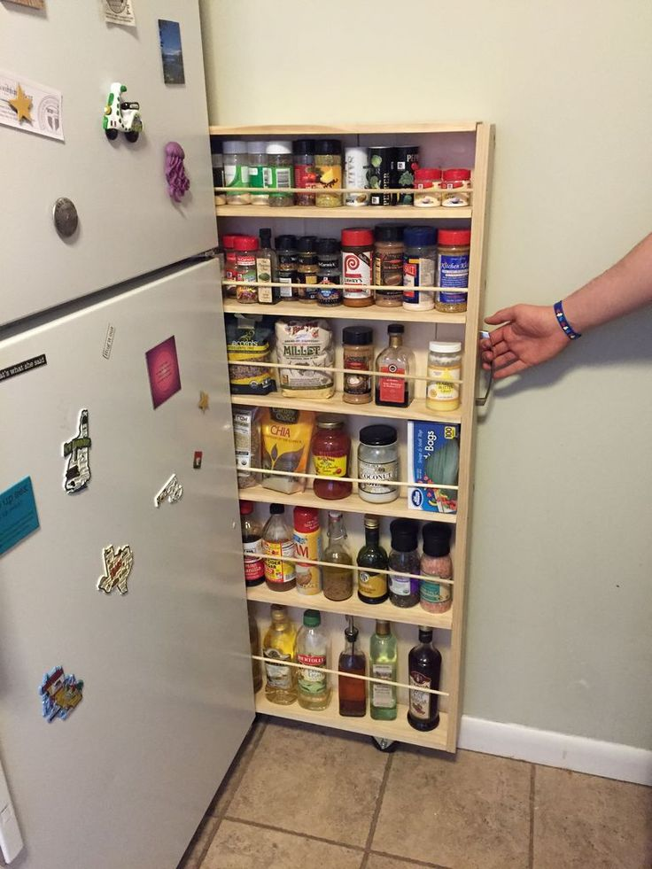 Hidden Fridge Gap Slide-Out Pantry http://www.instructables.com/id/Hidden-Fridge-Gap-Slide-Out-Pantry/