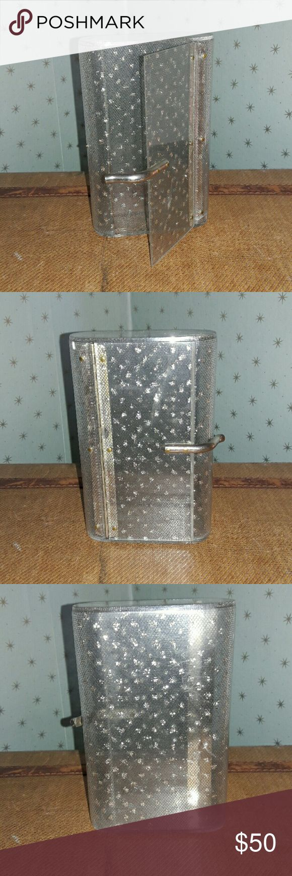 1950's Wilardy stardust glitter lucite clutch! Gorgeous lucite clutch. Measures 7x5x1.5 There are 2 fractures in the Lucite  (see pics). You have to look very closely to see them. Clutch has a black net lining with silver  confetti. Very glamorous, red carpet! These clutches retail for 400-650 in great condition. This one is in ok condition. It has been used and well loved! Bags Clutches & Wristlets