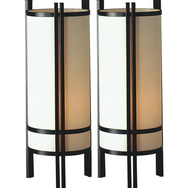 This Asian-inspired table lamp is the perfect complement to your contemporary decor. Ideal for use in the living room, bedroom, or home office, the lamp features a steel frame in black and a cylindrical shade, and it uses one 150-watt incandescent bulb (maximum not included).