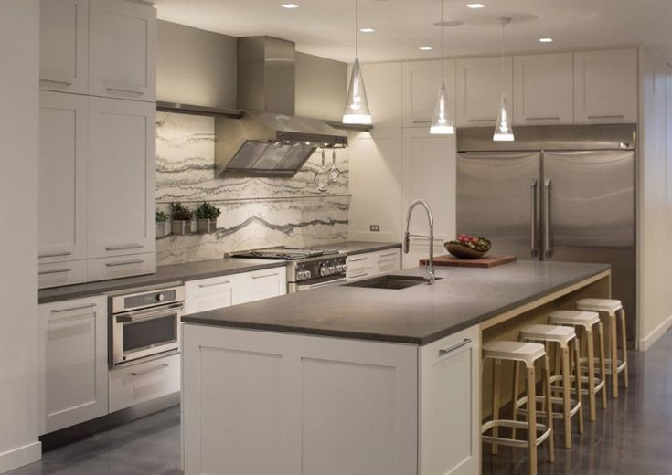 "Our modern kitchen design uses a clean white and slate palette to give a modern look that will ""wow"" guests and inspire your next dinner party."