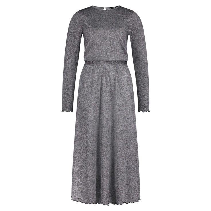 Das bodenlange Kleid KIKI von HOLY GHOST überzeugt durch den modernen metallischen Effekt. Die Taille wird durch ein Gummiband betont. Einen femininen Touch gibt der gewellte Saum und der Schlitz am Nacken. Das Münchener Label designte hier ein Kleid das lässig am Tag und sexy bei Nacht gestylt werden kann. Rocklänge: 80 cm (bei Größe S)