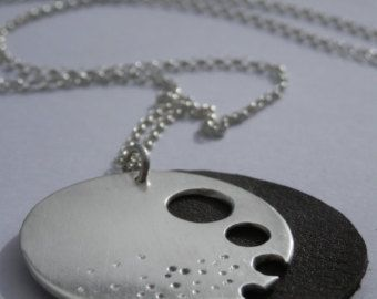 Sterling Silver and leather pendant.  Hand made jewellery in Ireland. Contemporary Irish Design.