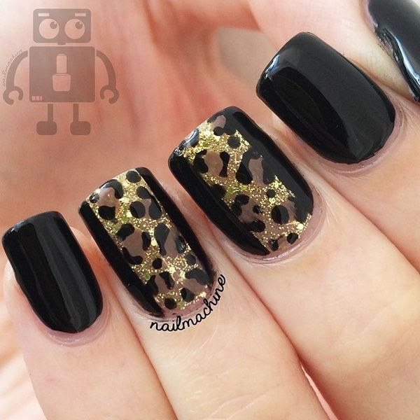 Black and brown leopard nail art design. The brown leopard prints are painted over the sharp black background causing it to look very much visible even from afar. The gold dust sprinkled all over the leopard prints look absolutely elegant.