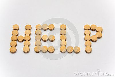 The word help spelled with cream color pills khaki color round pills. Unmarked medicine tablets. Closeup overdose concept image. Healthy painkiller prescription meds. Help sign for painkillers abuse. Light gray background.