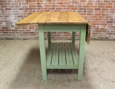 Old Pine Kitchen Island in bayberry green with drop leaf sides