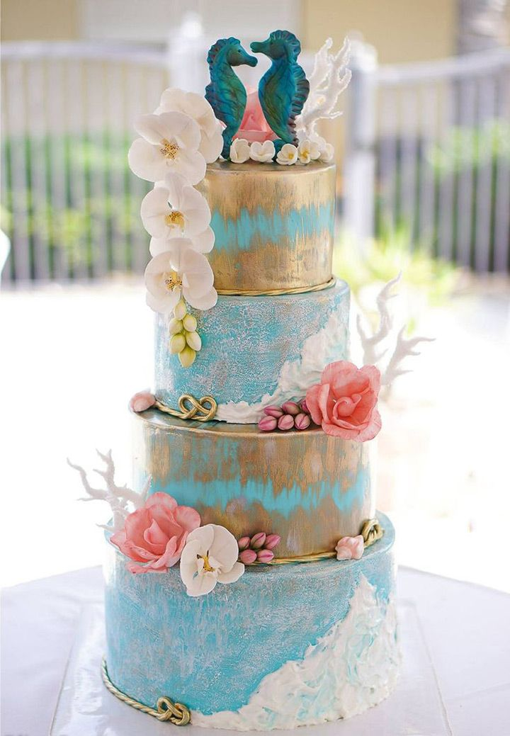 flecks of gold and a seahorse cake topper - lovely beach wedding cake! ~ we ❤ this! moncheribridals.com