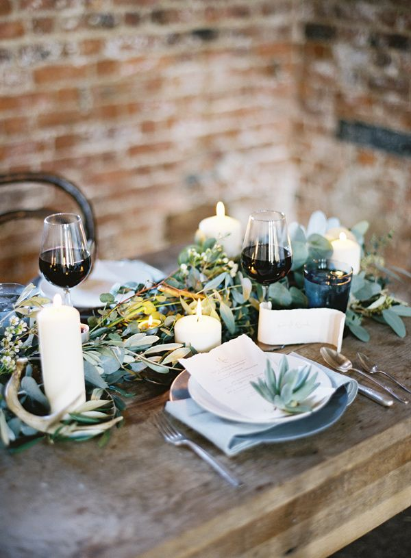 More table greenery with candles.  I like the antlers thrown in, too! – photo by http://www.paulaohara.com/ – http://ruffledblog.com/irish-destination-wedding-inspiration/