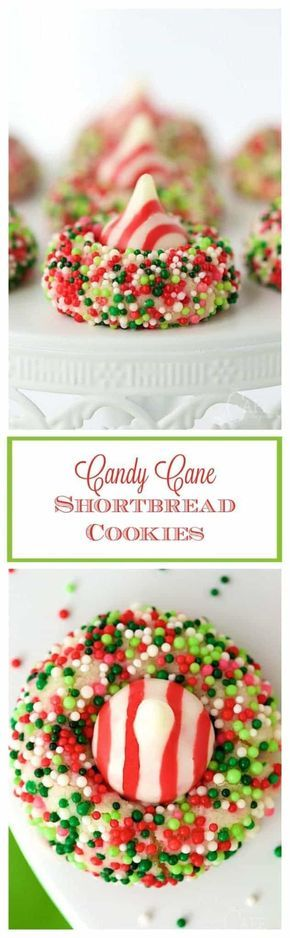 Candy Cane Shortbread Cookies - easy, whimsical and eye-catching, these incredibly delicious cookies have a buttery shortbread base and a sprinkle coating, topped with a Hershey's candy-cane kiss.