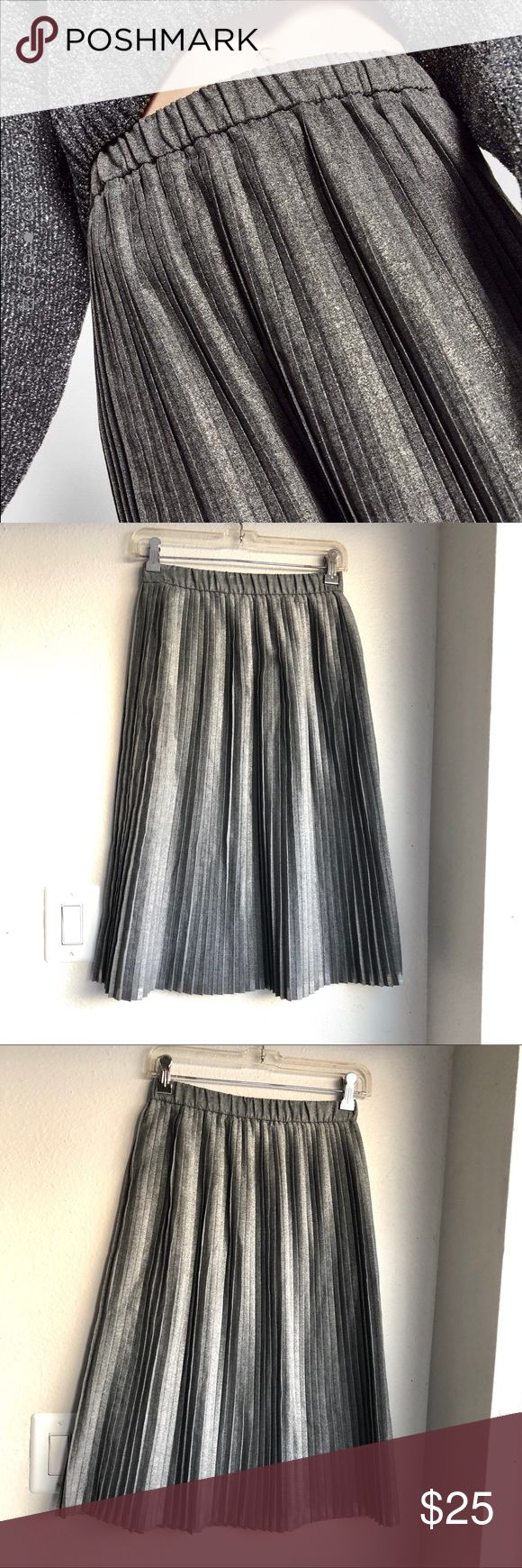 """🆕Zara Pleated Accordion Midi Skirt Gray Metallic Authentic Zara Trafaluc collection pleated midi skirt. Color is a gorgeous textured gray with metallic accents. Elasticized covered waistband. Size XS. Approx 26.5"""" long, 12.5"""" across waistband lying flat. Excellent condition, no stains/holes or signs of wear. Cover photo credit Zara. ❌No trades❌Price firm unless bundled. Zara Skirts Midi"""