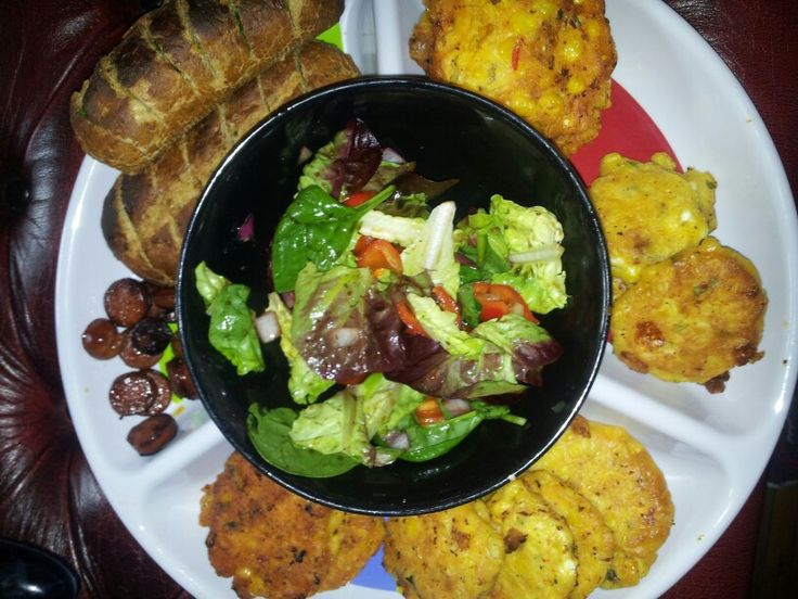 Pequeno tapas, sweetcorn fritters and home made garlic bread with chorizo and a simple balsamic salad