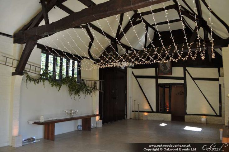 A classic fairy light canopy in for a barn wedding at Nether Winchendon. Spot our good looking wireless uplighters!